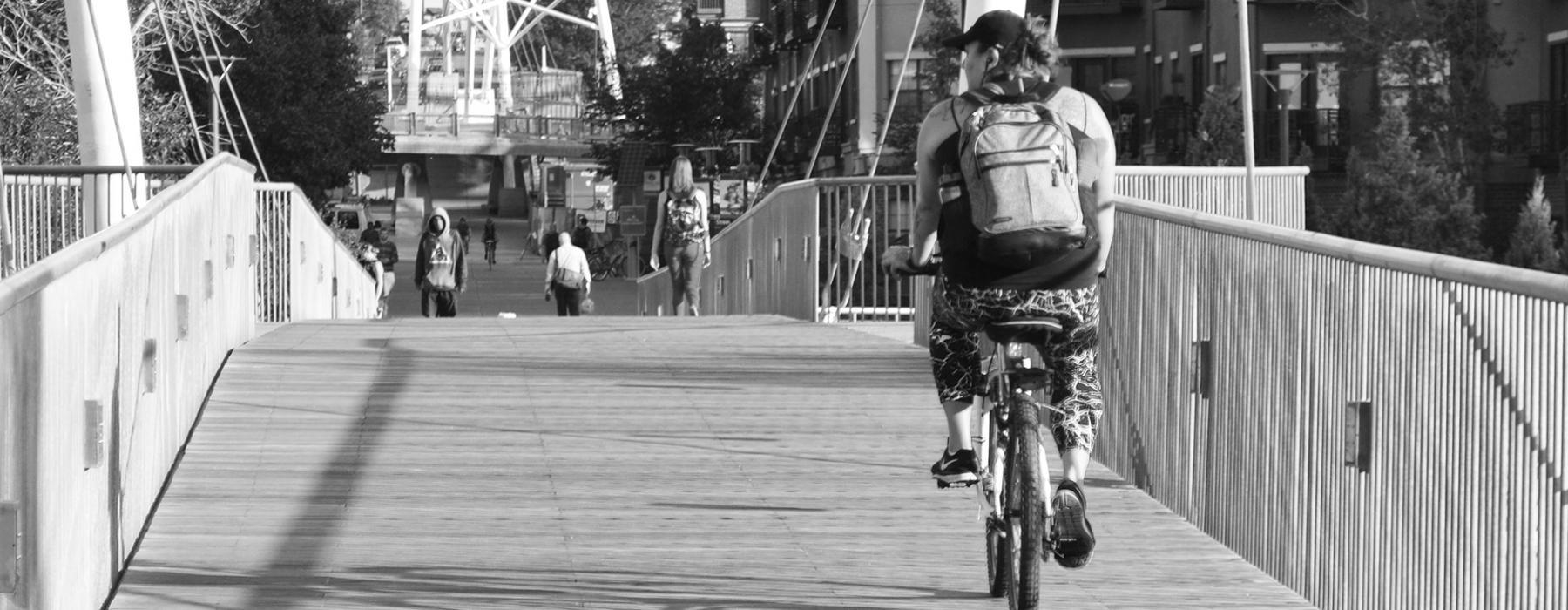 cyclist crossing pedestrian bridge