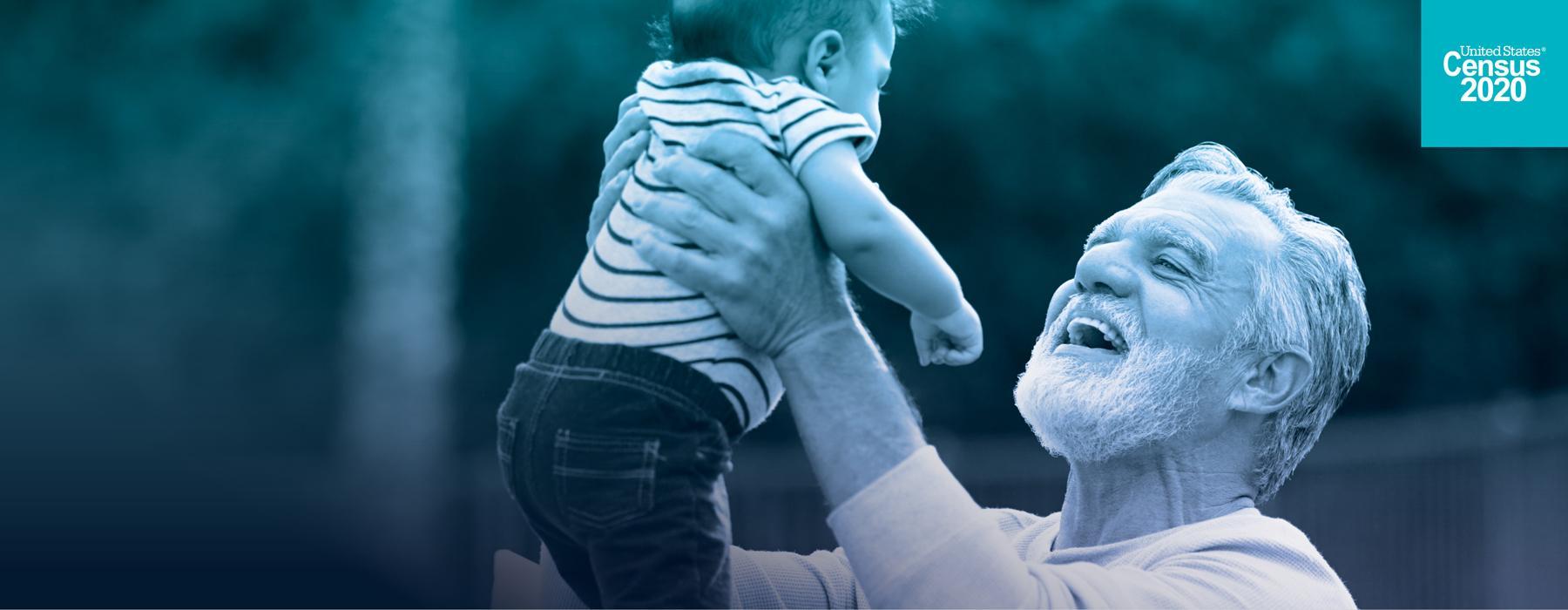 Older adult holding grandchild
