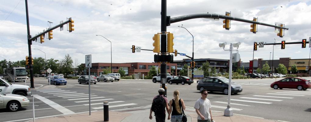 People crossing street at crosswalk