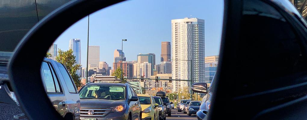 The Denver skyline, reflected in a vehicle's side-view mirror. Photo credit: Rey H. Sosa, photo contest finalist.