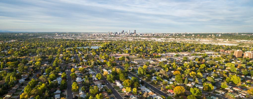 Metro Denver skyline city and residential with lake